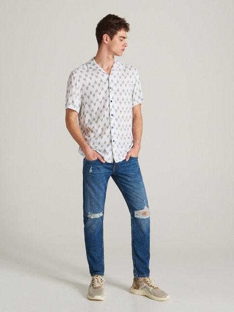 Worn effect slim jeans