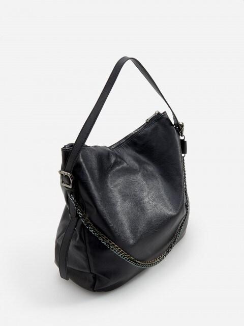 Handbag with decorative chains