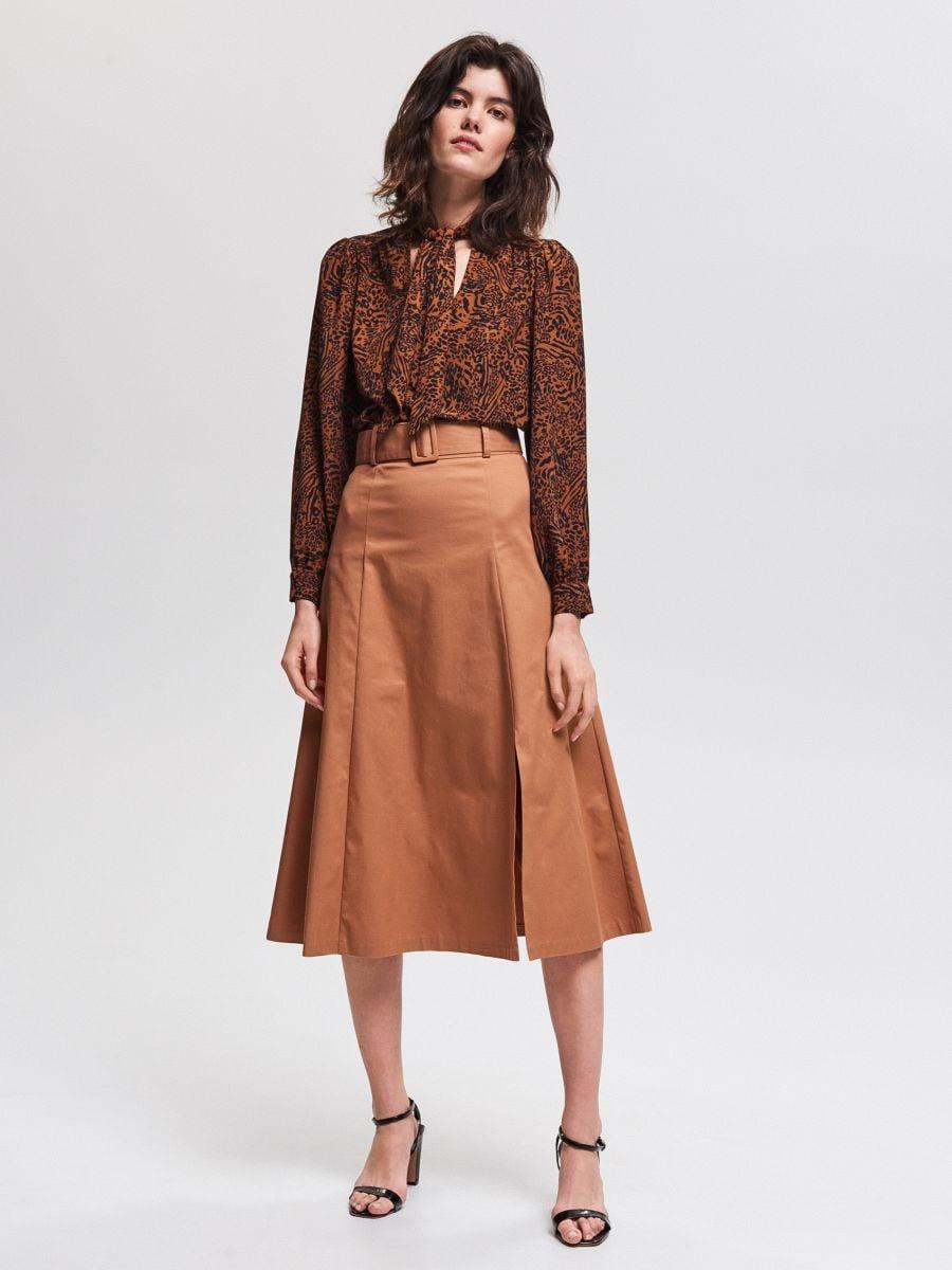 Platėjantis midi ilgio sijonas