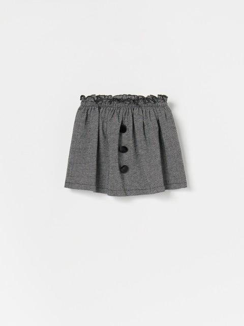 Žąsų kojelių rašto mini sijonas