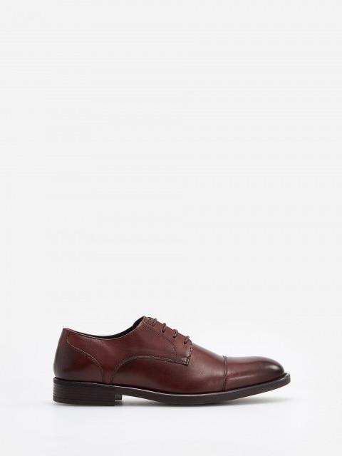 Ādas derbija stila kurpes