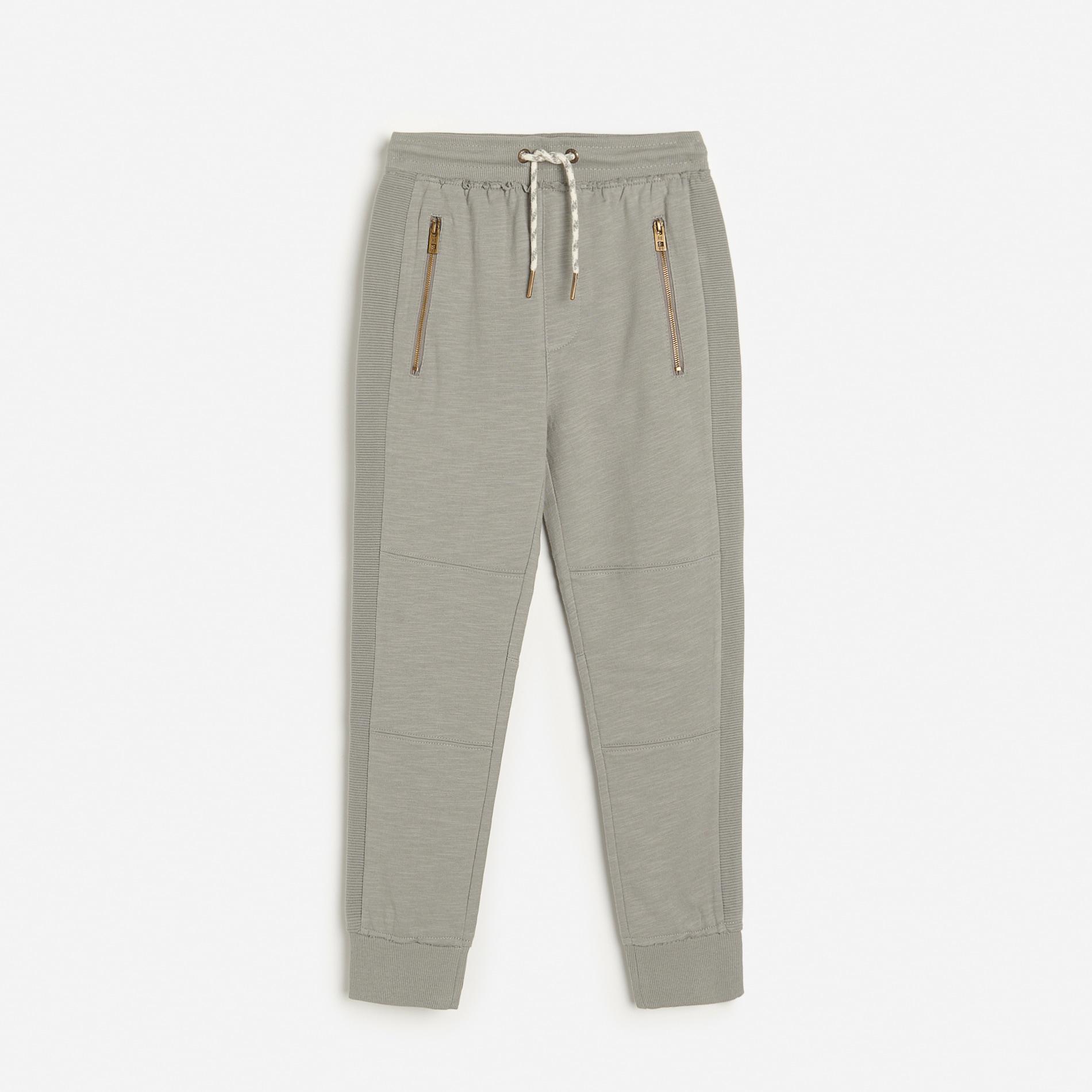 Reserved - Teplákové kalhoty joggers spostranními pruhy - Světle šedá