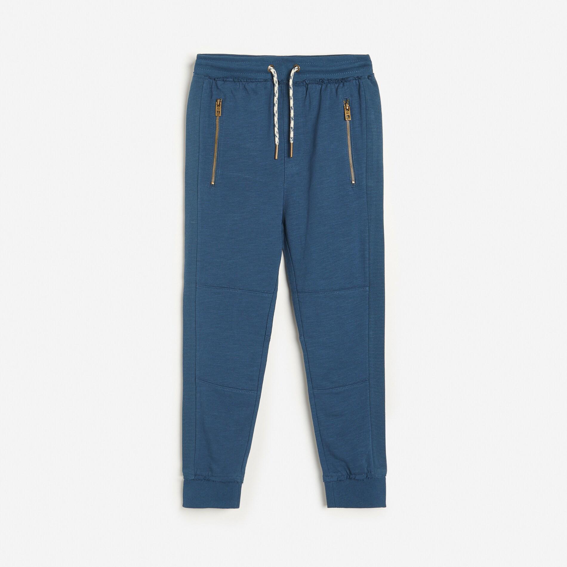 Reserved - Teplákové kalhoty joggers spostranními pruhy - Tmavomodrá