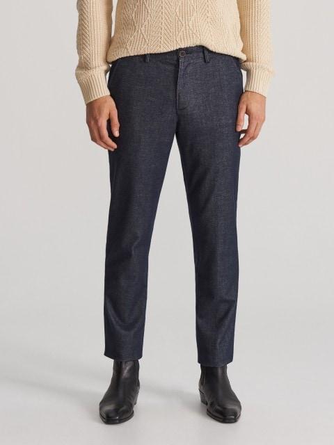 Обтислі штани-чиноси